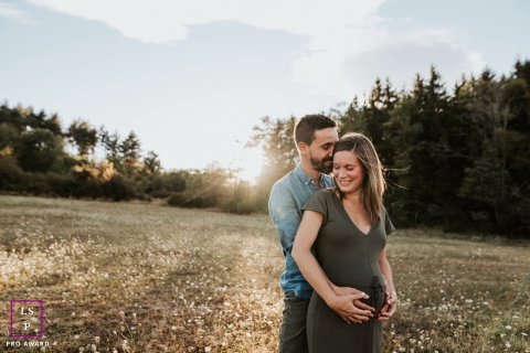 Rhone couple posing for a creative Lifestyle image while hugging in sunset at the fields