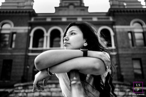 Knoxville young woman poses for a Lifestyle Black and white portrait in front of brick building