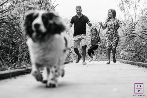 Doubs Family posing for a Lifestyle portrait with some BW hoopla with family