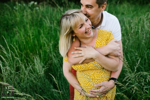 Doubs couple posing for a creative Lifestyle image with some fun laughs together