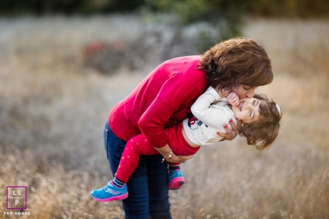 SF Family Lifestyle portrait with Mommy and kissing and tickling