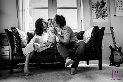 San Francisco Family posing for a Lifestyle portrait showing Mommy and Daddy love the baby to the moon and back