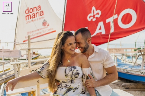 This is a lifestyle picture from Maceio of the Happiness moment on the beach with some sailboats behind the couple