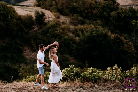 This is a lifestyle image of some couple Dancing at sunset in France