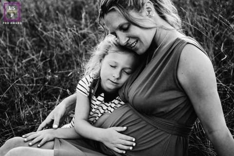 This is a lifestyle photo from Auvergne Rhone Alpes, France of some Instant tenderness during pregnancy time