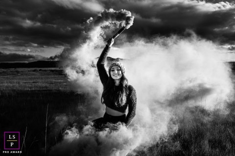 This is a lifestyle image showing a woman living Life to the fullest in SC, Brazil with smoke bombs