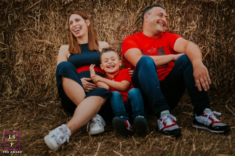 This is a lifestyle picture in bales of straw in Paris, France with matching red clothing