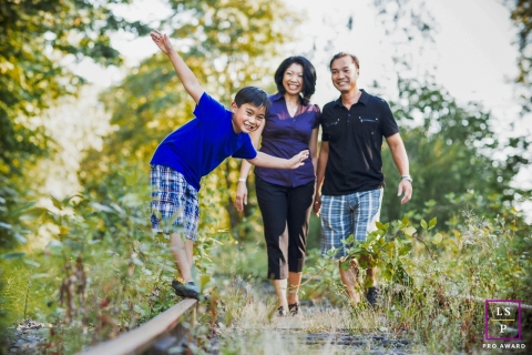 This is a lifestyle photo showing Happy family time in the park in SF, Northern California on the railroad tracks