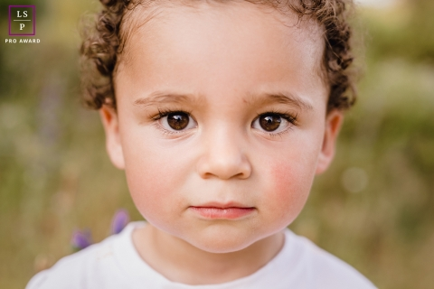 This is a lifestyle photo of a little boy during a close up portrait in Herault, Occitanie