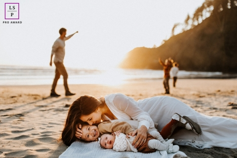 This is a lifestyle newborn session on a blanket on the sand from Indian Beach, Oregon of