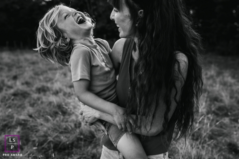 This is a lifestyle photo of a young child fooling around with mom in Doubs