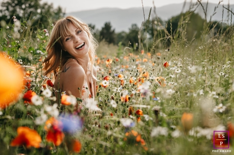 This is a lifestyle Portrait session in field full of flowers with a young woman in Pyrenees-Orientales, France