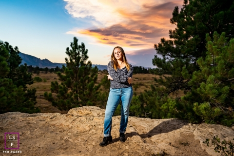 This is an outdoor, daylight, lit lifestyle photo of a young woman from Boulder, Colorado