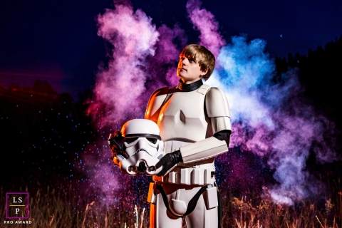This is a lifestyle picture from Morrison, Colorado of for a smoke bomb Senior portrait in Star Wars Stormtrooper armor
