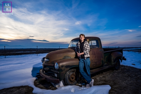 This is a lifestyle image during a Senior portrait session with antique truck in Broomfield, CO