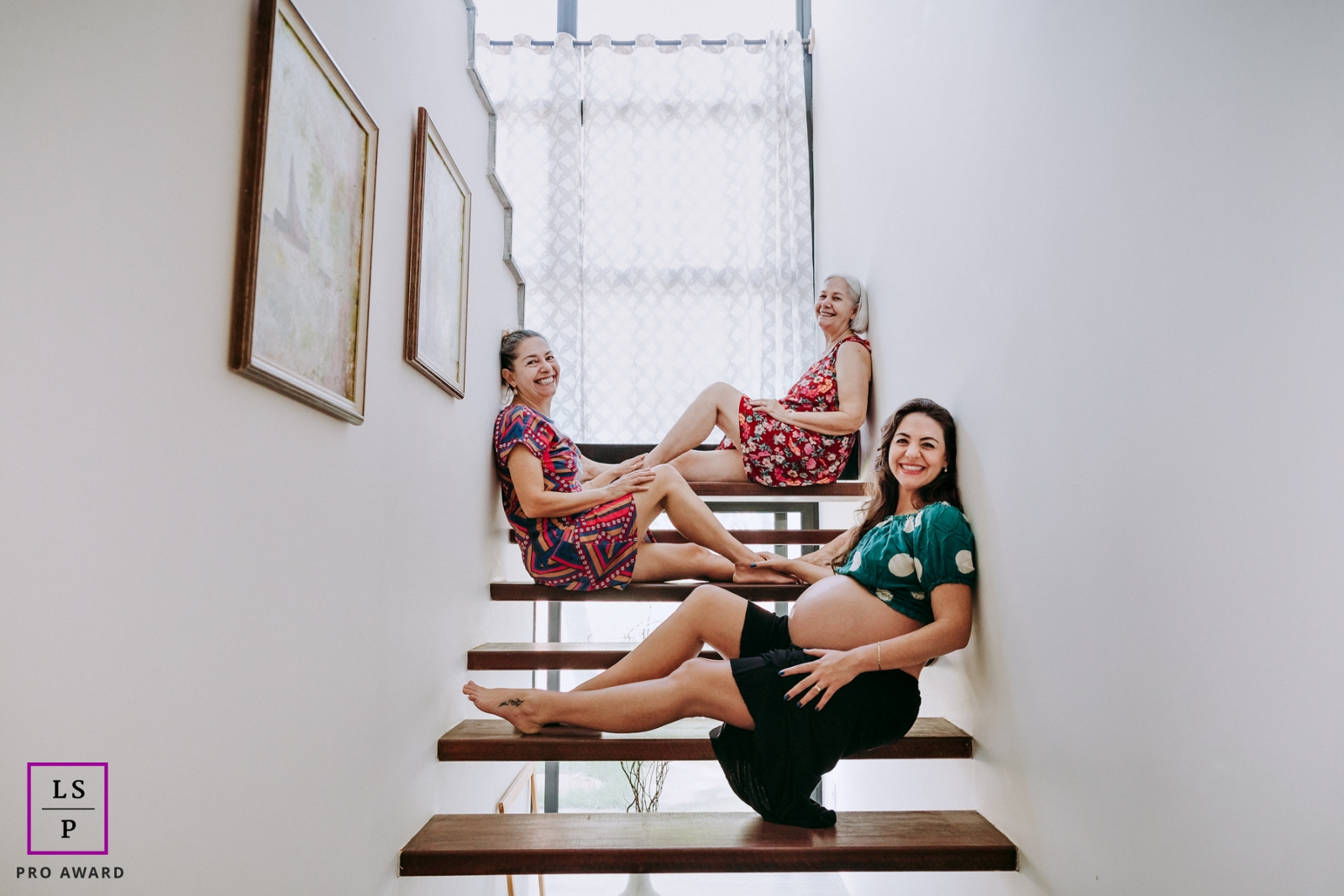 Rio de Janeiro Creative Lifestyle Portrait image of grandmother, mother, daughter and granddaughter (still in the belly) posing for family photo on the stairs of the house