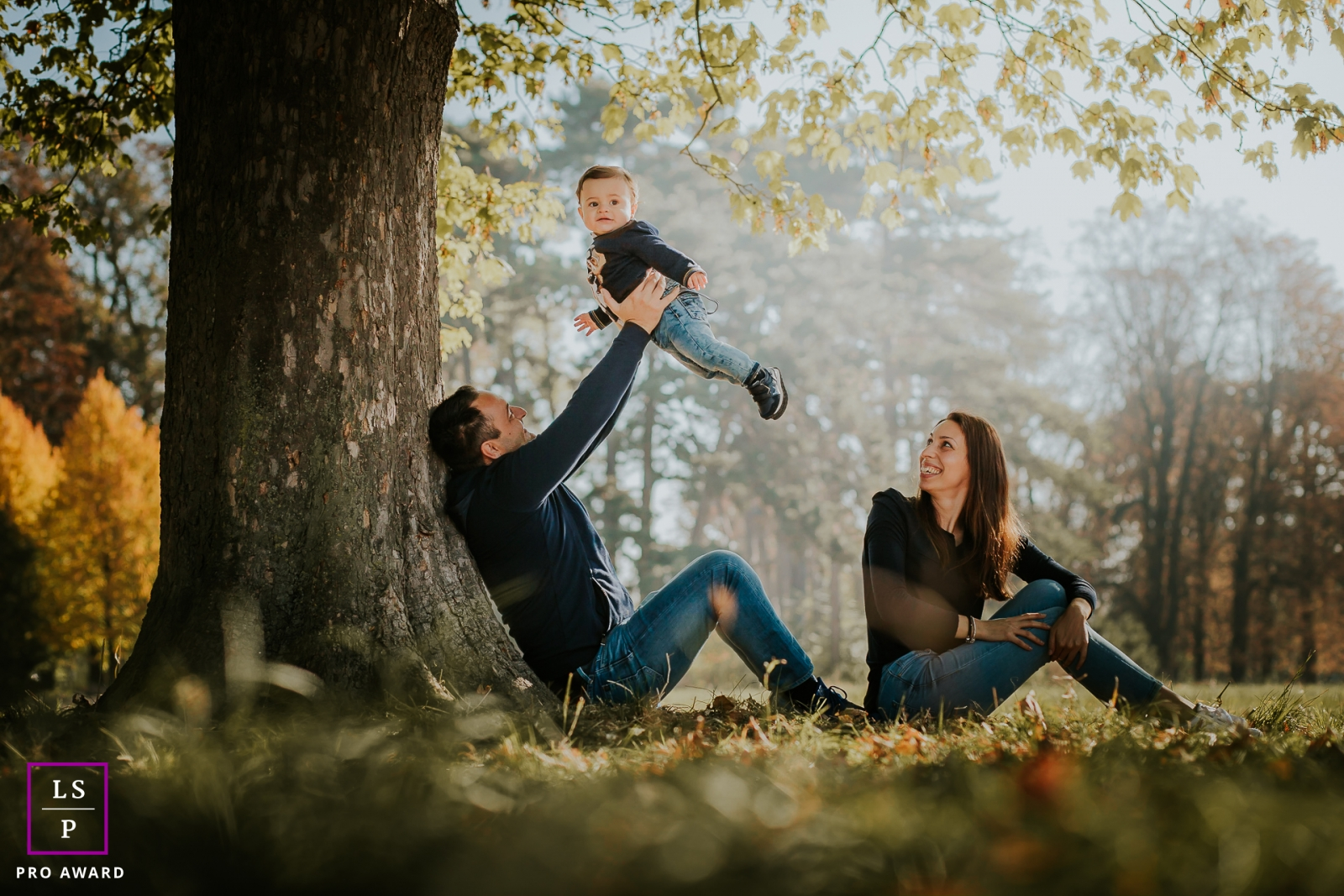 Paris Family Portraits at the Park | Image contains: husband, wife, sitting, toddler, boy, grass, trees