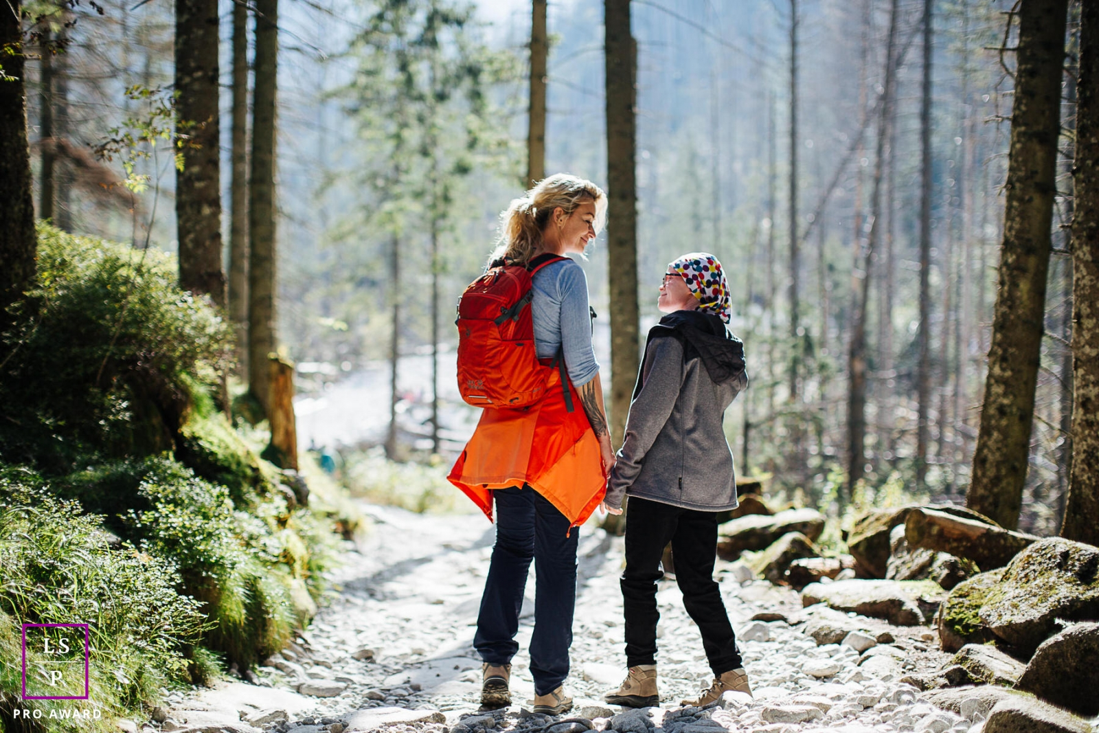 A mother and daughter lifestyle portrait on a walking trail in Poland.
