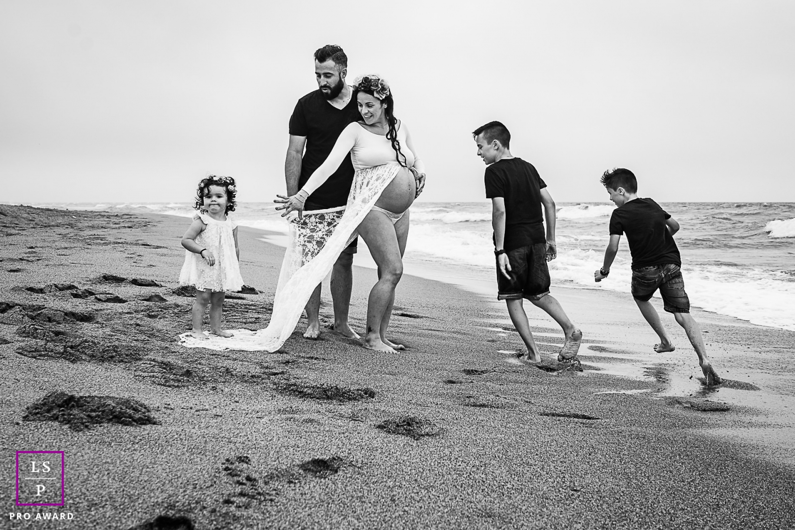 Perpignan Creative Lifestyle Family Portrait image taken while playing on the beach sand