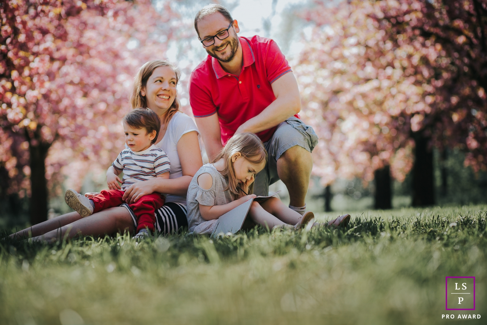 Ile-de-France Lifestyle Photography for the Family | Image contains: grass, husband, wife, kids, trees, park