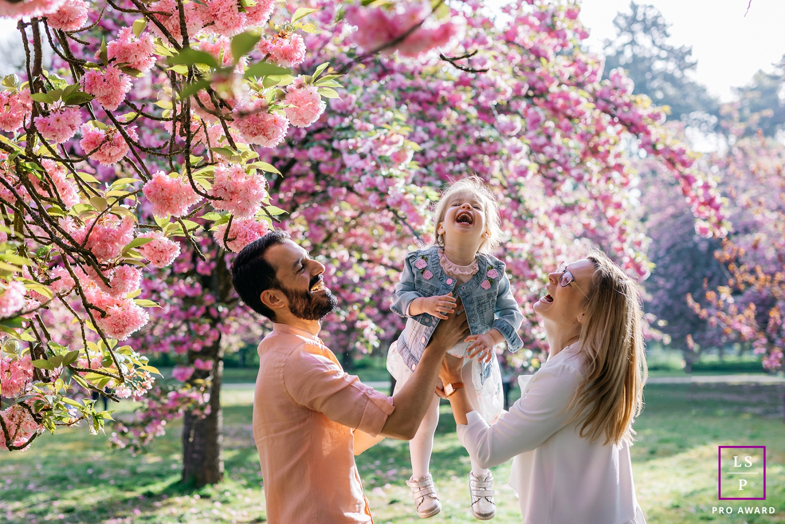 Occitanie Lifestyle Family Portrait Session in Herault   Photo contains: bloom, blossom, tree, girl, mom, dad, outdoors