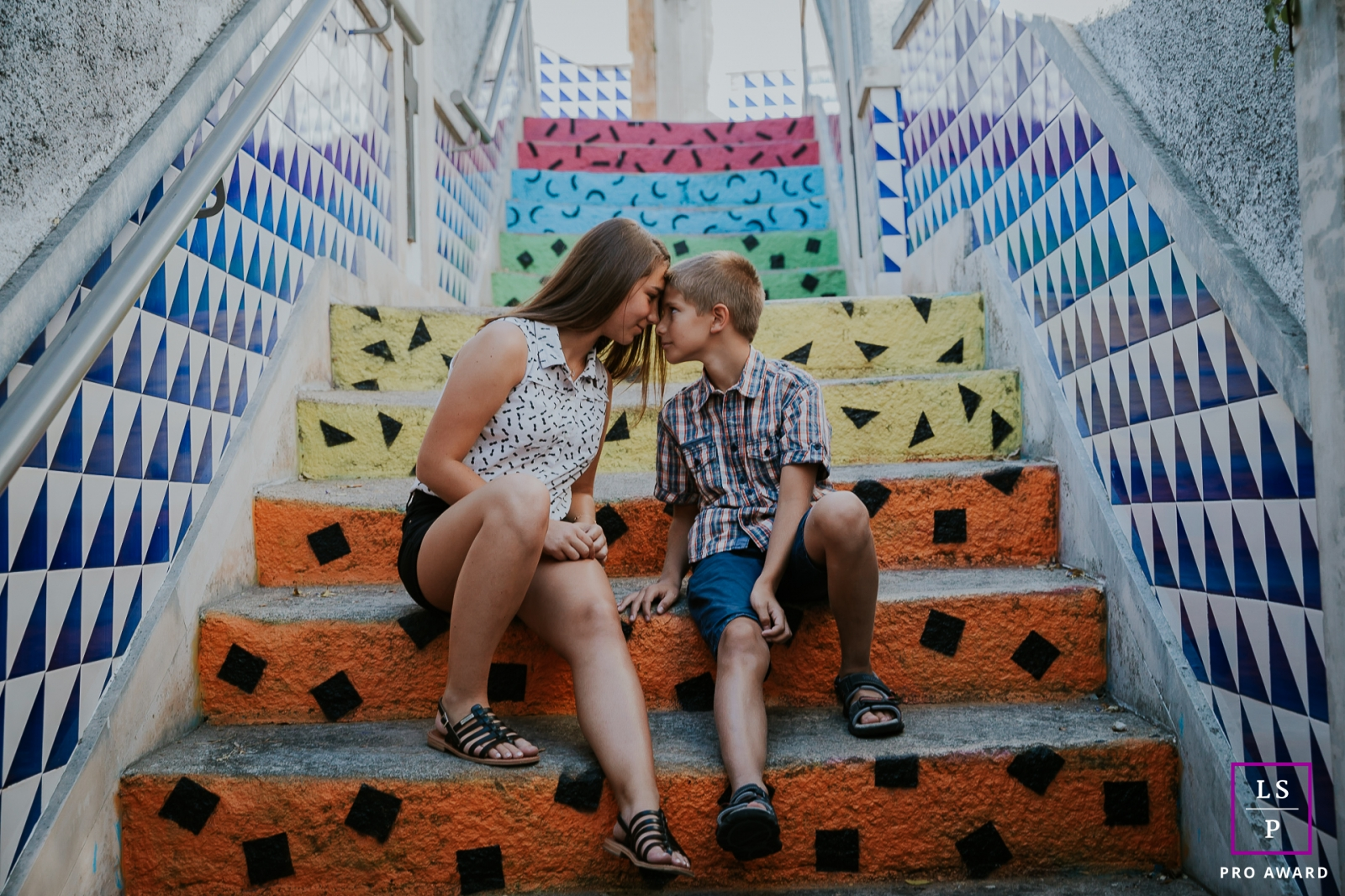 Family Photographer for Ile-de-France | Lifestyle Image: Brother and Sister love the colors on these stairs