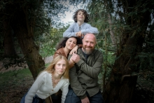 Artistic Pays de la Loire Lifestyle Photography showing a family posing in the trees